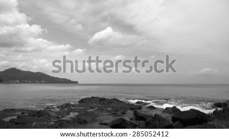 The stone beach and the sea in toned black & white