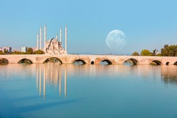 The Stone Bridge and Sabanci Mosque with full moon - Adana, Turkey