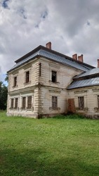 The stone building is dilapidated. A dilapidated abandoned building.