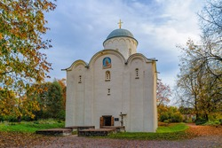The stone church of the Assumption of the Blessed Virgin Mary (XII century) is the main attraction of the Old Ladoga Holy Dormition Maiden Monastery on a sunny autumn day. Staraya Ladoga, Russia.