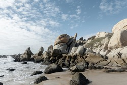 The stone coast of Vietnam. Large boulders on the beach.
