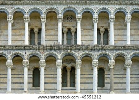 The stone columned galleries of the West facade of Pisa Cathedral  (Catedral de Pisa), Italy