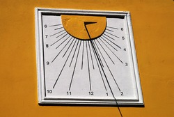 The stone-made sun-dial of the church of Agios Ioannis at Symi island in Greece.