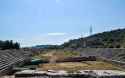 The stone ruins with the parts of sits and staircases of ancient antic stadium in Perge, Antalya, Turkey.