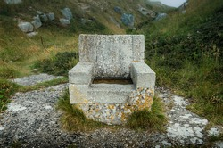 The stone throne sculpture at Tout Quarry Nature Reserve and Sculpture Park, Portland, Weymouth, Dorset, England, UK