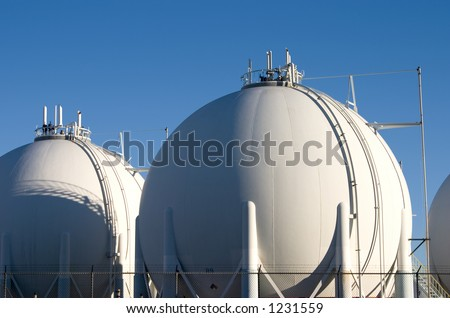 The storage tanks of a modern oil refinery.