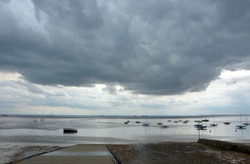 The stormy weather over the Thames river at Thorpe Bay in Essex, Uk