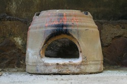 The stove is a traditional Indonesian cooking tool made of stone or brick, which was used for cooking in earlier times