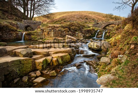 The stream flows among the hills. Rivers tream on hill. River creek flowing