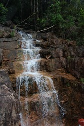 The stream of water falls down the stone steps