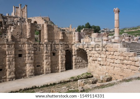 The street in ancient Roman city Gerasa  or modern Jerash and ruins of temple overhead