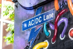 The street sign for AC/DC Lane in the city of Melbourne, Australia