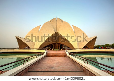 The striking and flowerlike architecture of the Lotus Temple with nine sides, 27 petals and nine entrances. Photo taken in 1st of June 2018, New Delhi, India.