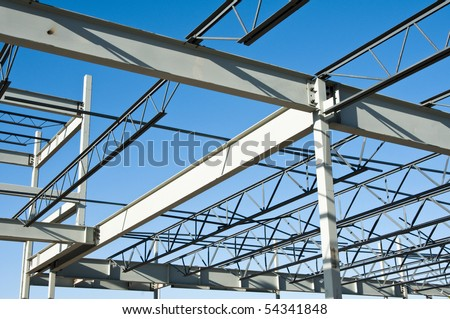 the structural steel structure of a new commercial building against a