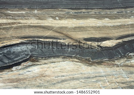 The structure of natural black marble. Gray marble with yellow stripes. Beautiful vintage background #1486552901