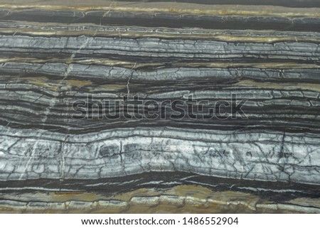The structure of natural black marble. Gray marble with yellow stripes. Beautiful vintage background #1486552904