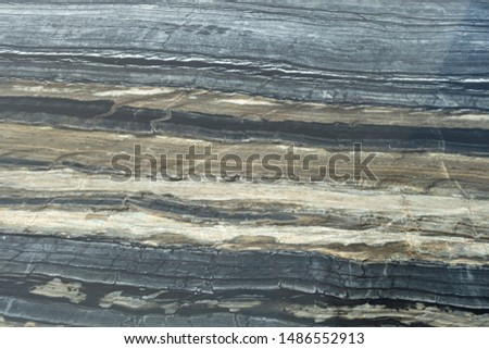 The structure of natural black marble. Gray marble with yellow stripes. Beautiful vintage background #1486552913