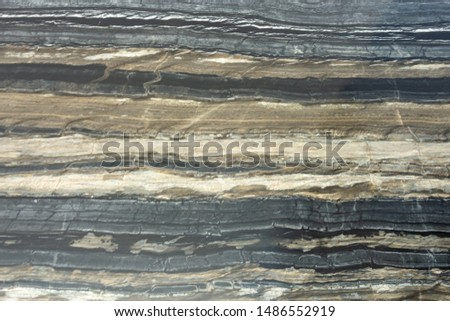 The structure of natural black marble. Gray marble with yellow stripes. Beautiful vintage background #1486552919