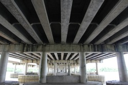 The structure of the beams and  bunting  for bearing under the bridge across the river.