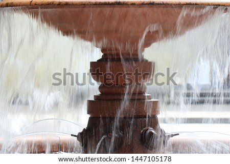 The structure of the water jet fountain on the background of the bowl of the fountain #1447105178