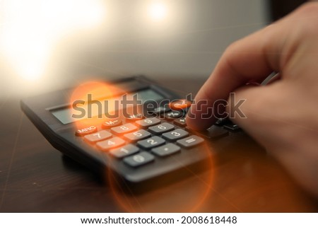 the student solves math problems using a calculator. Preparation for year-end tests. Learning difficult math problems Zdjęcia stock ©