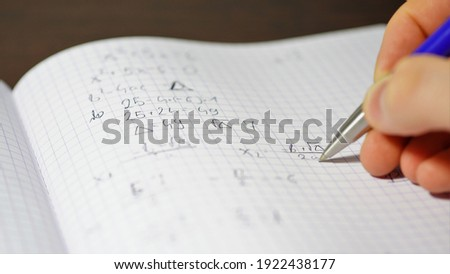 the student solves quadratic equations. High school graduation. Repeating for the exam. Counting the unknown side of a triangle Zdjęcia stock ©