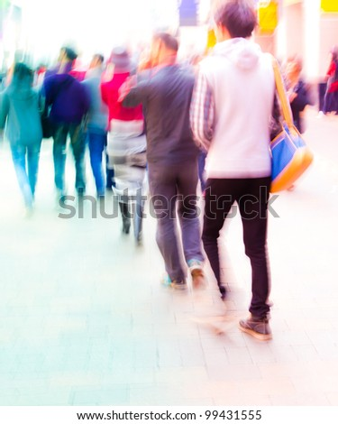 the students walking on campus in intentional motion blur