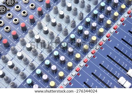 The studio audio mixer, close-up