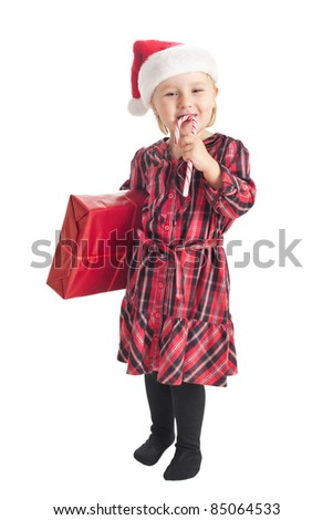 the studio shot of little girl with xmas gift