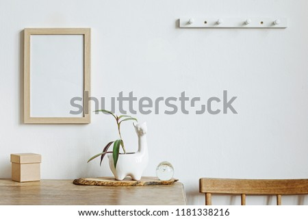 The stylish interior with mock up photo frame, lama pot and small box.The minimalizm concept of space.  Stok fotoğraf ©