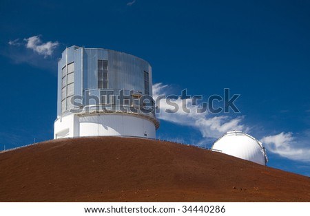 The Subaru Observatory atop the Mauna Kea volcano in Hawaii Big Island. Part of the Keck Observatory is also visible.