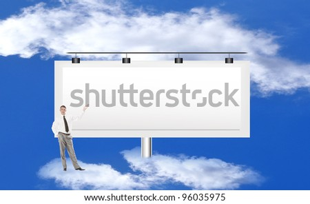 The successful businessman against a publicity board and the bright blue cloudy sky