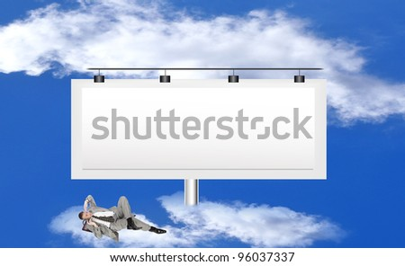 The successful businessman against a publicity board and the bright blue cloudy sky - stock photo