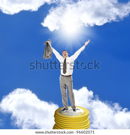 The successful businessman over blue sky background
