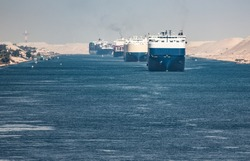 The Suez Canal is a shipping canal in Egypt.A cargo ship drives the Suez Canal.