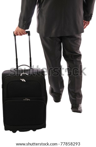 The suitcase carried by businessman