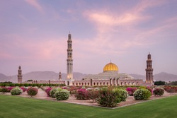 The Sultan Qaboos Grand Mosque in the middle east, Oman, Muscat, at sunset.