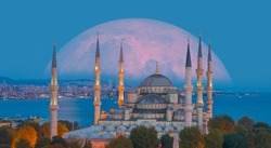 The Sultanahmet Mosque (Blue Mosque) with full moon - Istanbul, Turkey