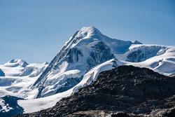 The summit of Liskamm, famous alpine peak above Zermatt, Switzerland. Moutain alpine landscape of Wallis. Snow and ice covered peak, Monte Rosa Glacier.