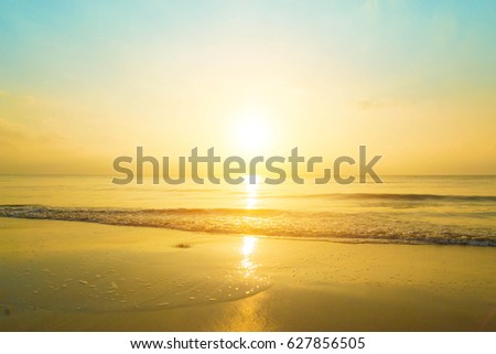 The sun began to rise from the sea in the morning. #627856505