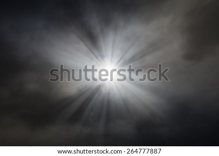 the sun breaks through the thick clouds