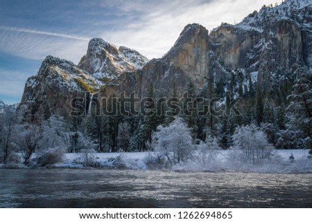 The sun creeps over the top of an icy Bridalveil Falls in Yosemite National Park