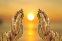 The Sun in The Buddha hands abstract Religion gives light to everyone in the world.