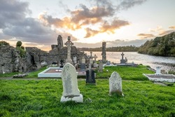 The sun is setting above the Abbey Graveyard which was build by Hugh O Donnell in 1474 - all names and artwork removed