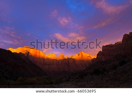 The sun kisses the top of the Towers of the Virgin at Zion Canyon National Park, Utah.