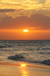 The sun reflecting on the sea in an amazing orange sunset in Varadero, Cuba