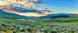 The sun rises over the Lamar Valley near the northeast entrance of Yellowstone National Park in Wyoming.