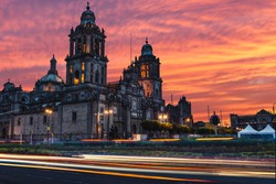 The sun rises over the Mexico City Metropolitan Cathedral in the Zocalo Square of Mexico City, Mexico.