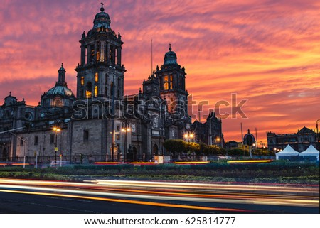 The sun rises over the Mexico City Metropolitan Cathedral in the Zocalo Square of Mexico City, Mexico. #625814777
