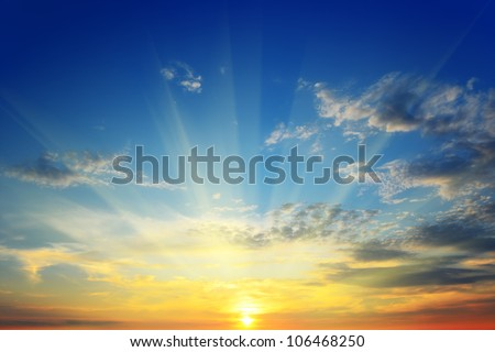 the sun's rays illuminate the sky above the horizon